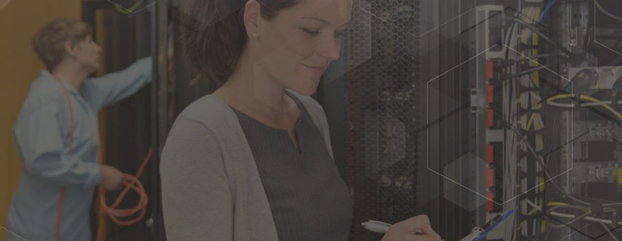 Woman IT engineer in server room checking network